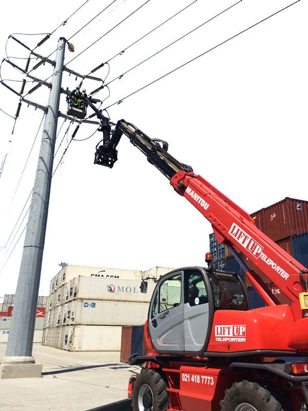 A mobile crane telehandler working on an electricity pylon in Cape Town