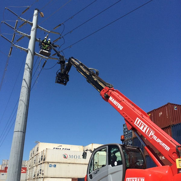 Telehandler mobile crane working on electricity pylons