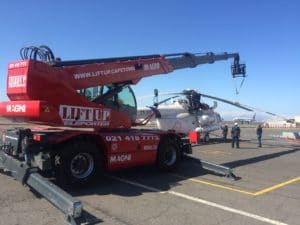 Mobile crane lifting the rotors off a helicopter