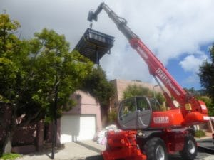 A mobile crane telehandler lifts a swimming pool over a telephone line - Liftup Teleporter