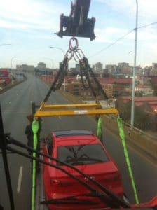 Mobile crane carries a car in a TV advert filmshoot