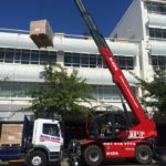 Telehandler mobile crane works without blocking traffic