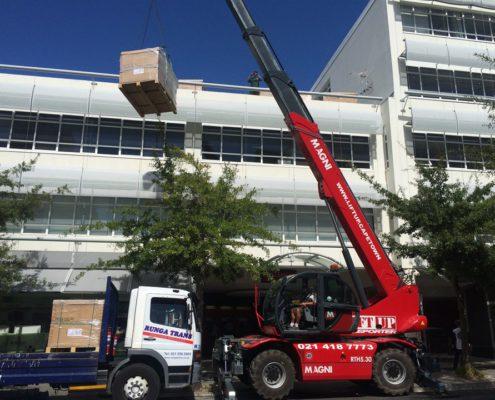 Telehandler mobile crane works without blocking traffic