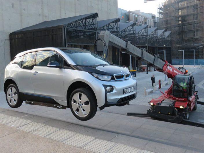Telehandler lifting a car for a launch
