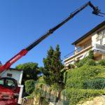 Mobile crane lifting bricks up a slope