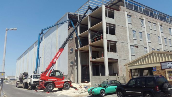 Mobile crane lifting equipment on a building site