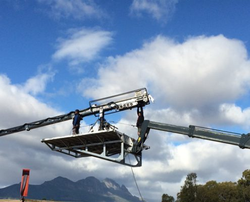 Mobile crane camera platform supporting supertechno camera crane.
