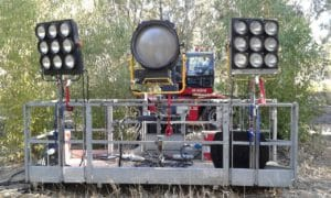 Film set lights mounted on a mobile crane platform