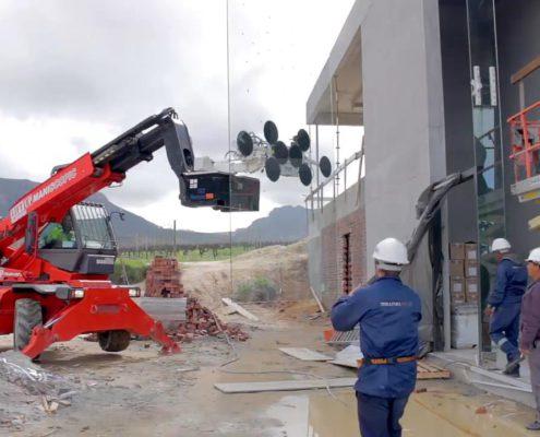 Mobile crane lifting heavy glass