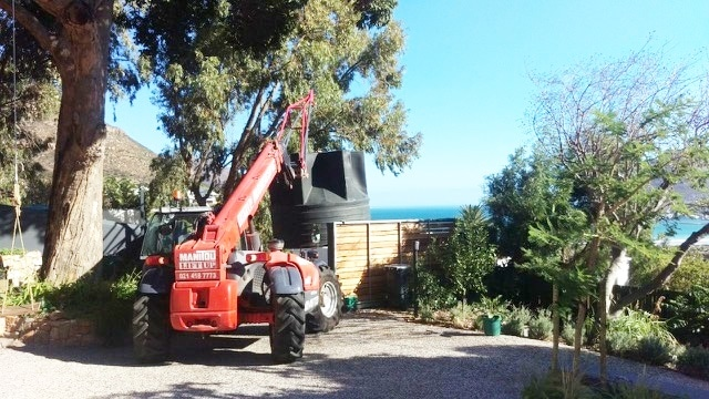 Telehandler lifting a large water tank in Cape Town
